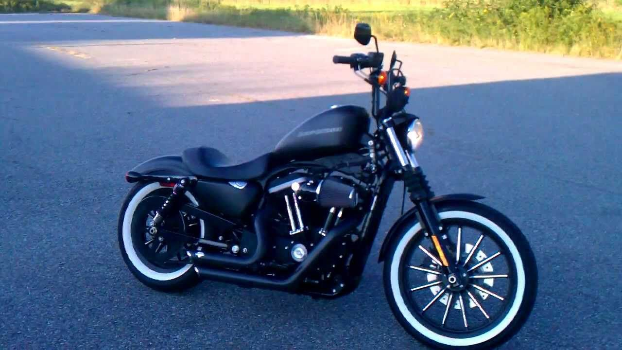 Iron 883 with Vance and Hines short shots, white walls, Z-bars and a ...