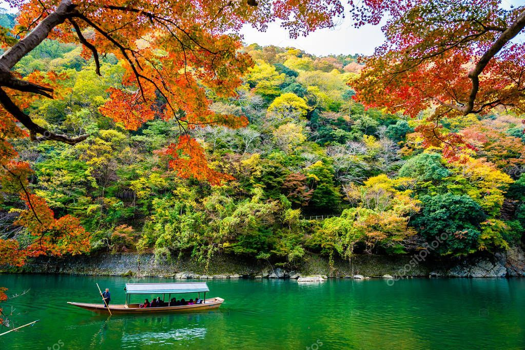 Beautiful Arashiyama river with maple leaf tree and boat around - Stock P , #Affiliate, #river, #maple, #Beautiful, #Arashiyama #AD
