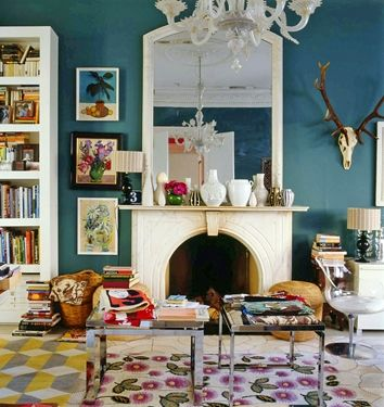 Love the colors. You can tell someone lives in the space but it still looks posh and sophisticated. Love the head on the wall & the chandelier. Very eclectic.