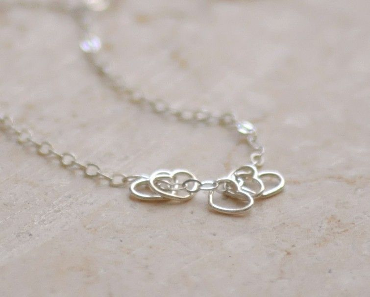 Little hearts necklace - tiny sterling silver open hearts necklace - delicate jewelry - edor. $23.00, via Etsy.