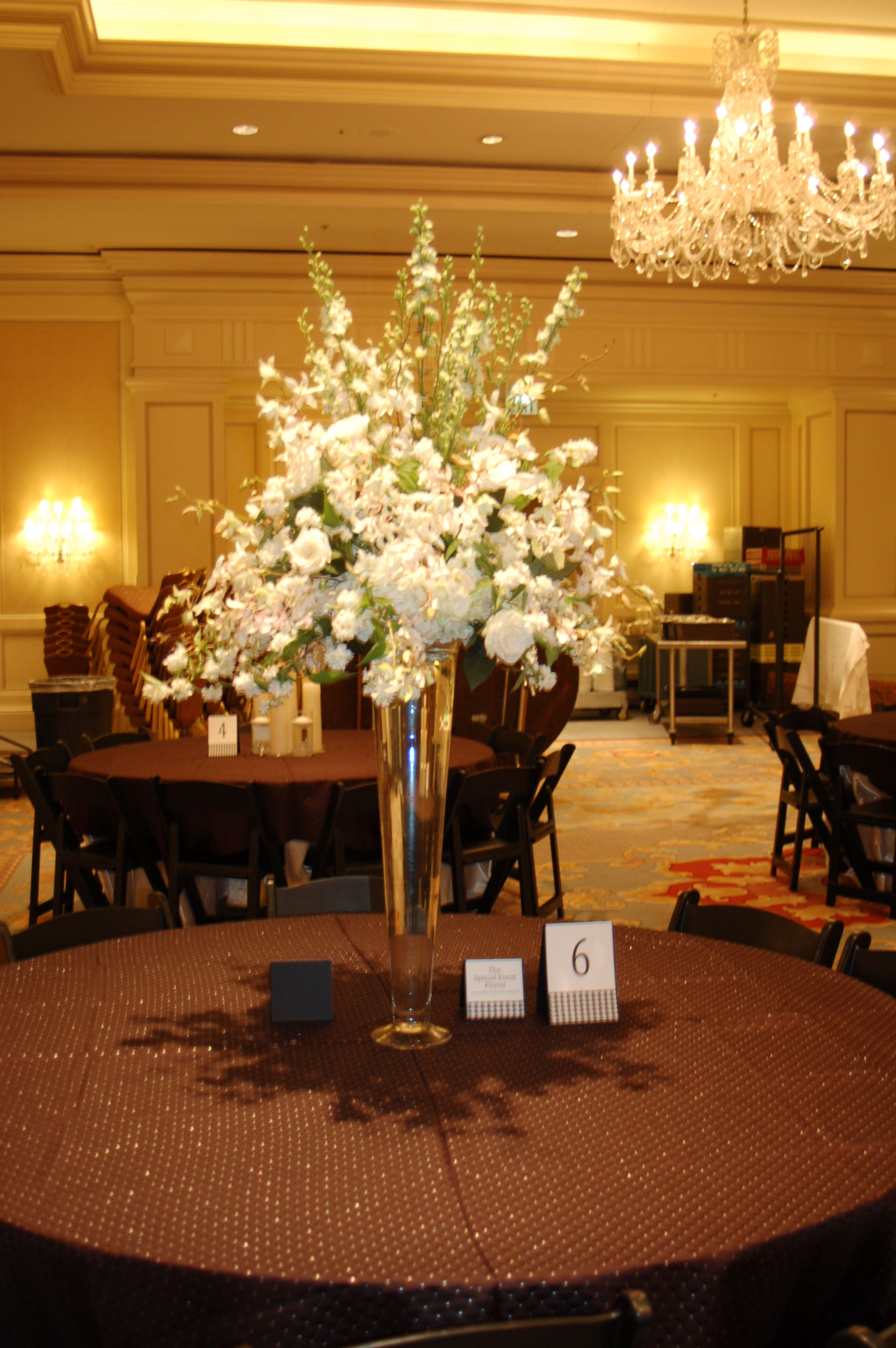 Large Centerpiece Of White Hydrangeas Larkspur Orchids And Spirea Designed By Tina Barrera Tall Centerpieces Large Centerpiece Reception Arrangement