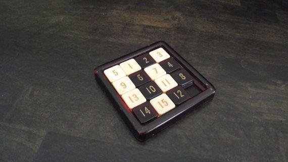 Vintage Bakelite 15 Game Puzzle by Rudolf Steiner