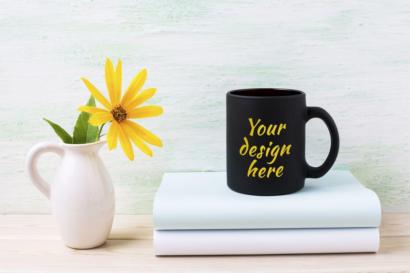 Black coffee mug mockup with yellow rosinweed flowers in