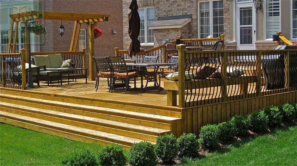 beautiful full cedar deck with a gorgeous pergola really on steps in discovering the right covered deck ideas id=60840