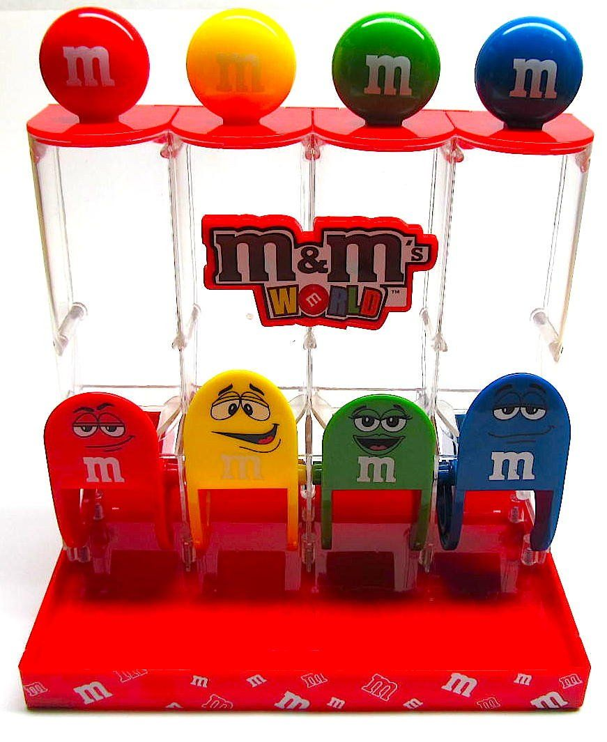 M&M'S World Colorworks Candy Dispenser features four of the most popular M&M Characters. Fill the dispenser with M&M candies and watch them disappear. #mandms
