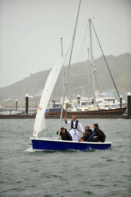 Rodney Patterson With The Torch On A Sailing Boat At