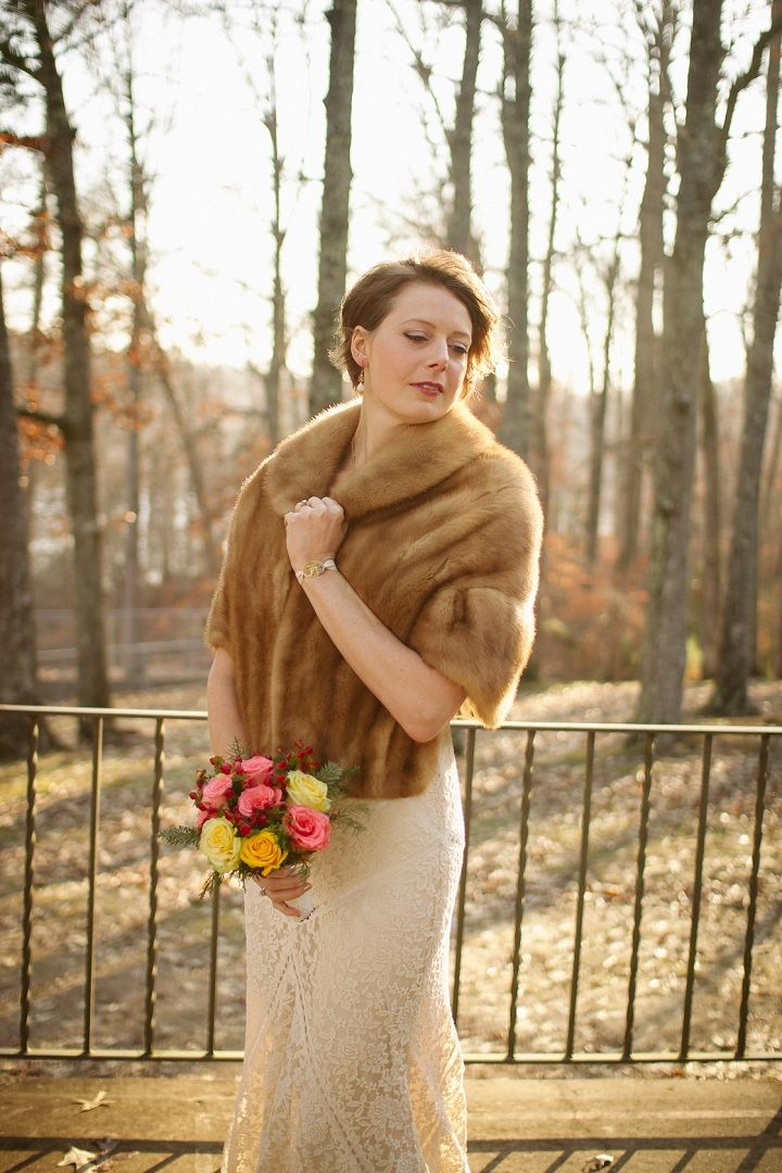 The bride wears lace sheath wedding dress under fur shrug for winter wedding | fabmood.com #jeweltones #winterwedding #wedding #quirkywedding