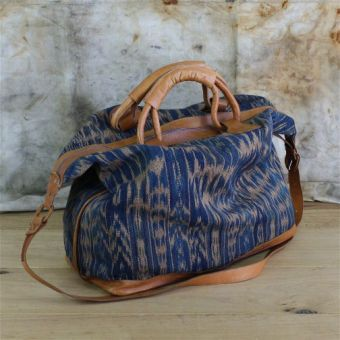 Ikat leather weekender bag. I love this whole site so I'm putting this in my…