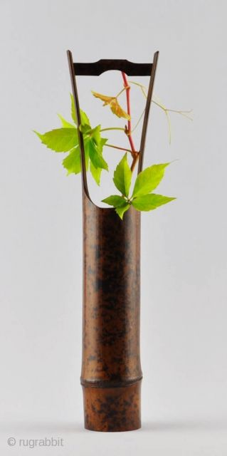 An Elegant Simple Japanese Flower Vase (hanaire) Of Dark Bamboo With A  Natural Design Of Black Spots And An Attractive Patina.
