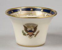 # 32                          State dinner service of Franklin Delano Roosevelt (President 1933-1945)--Cocktail Cup/Made in Trenton, New Jersey, United States, North and Central America c.1934--Made by Lenox Incorporated, Trenton, New Jersey, 1889 - present. Ordered from William H. Plummer and Company, New York. Porcelain with printed, enamel, and gilt decoration. 1 13/16 x 2 7/8 inches (4.6 x 7.3 cm)