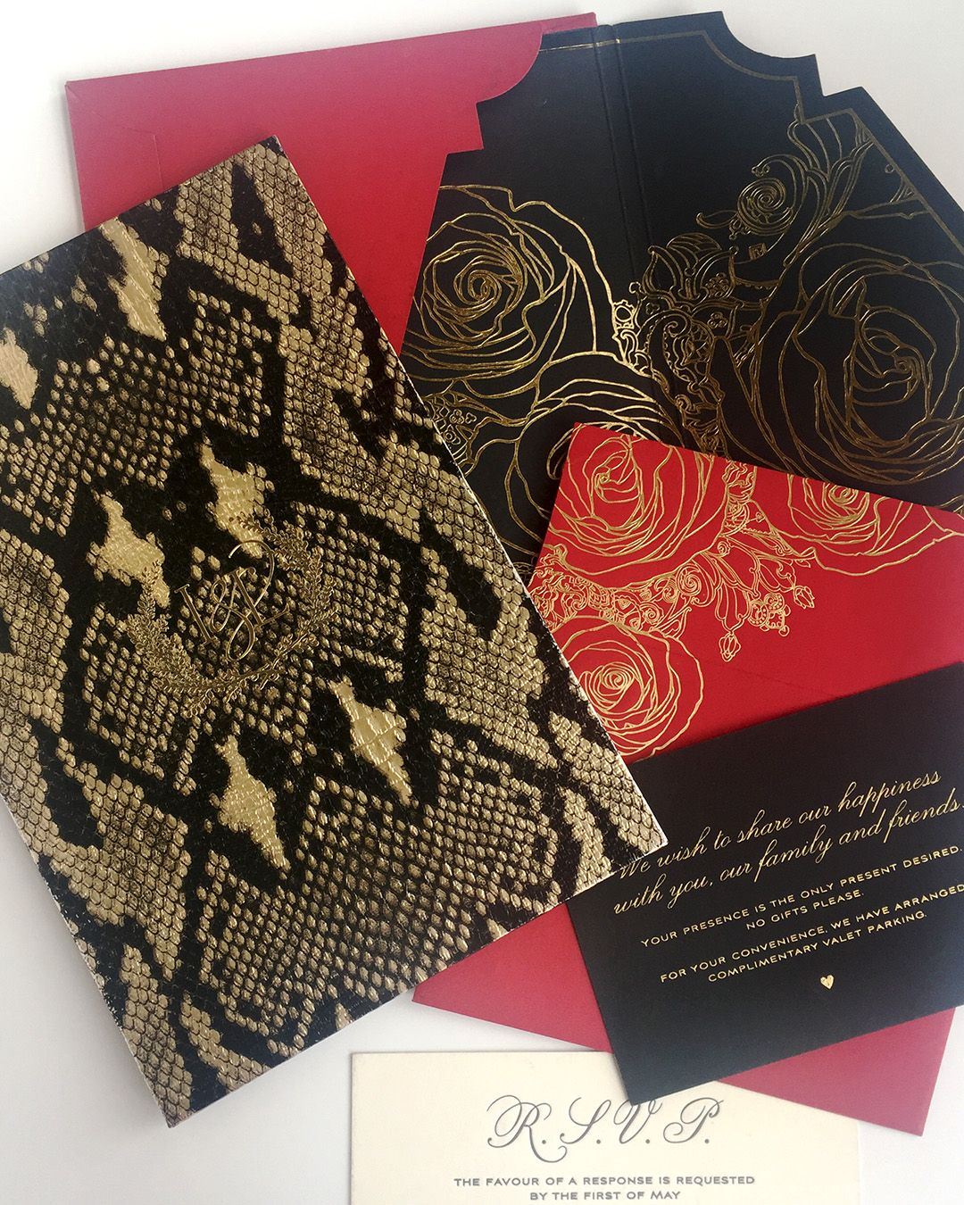 Red and black invitations with python textured paper, gold foil ...