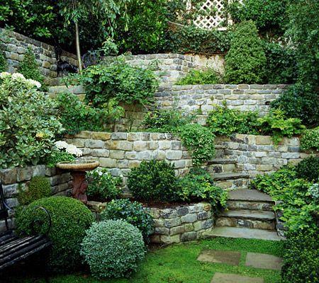 The Look Of Greenry And Stone Elizabeth Everdell Garden Design Sloped Garden Garden Design Tiered Garden