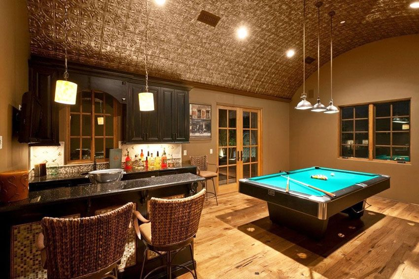 custom home bar in basement game room with pool table