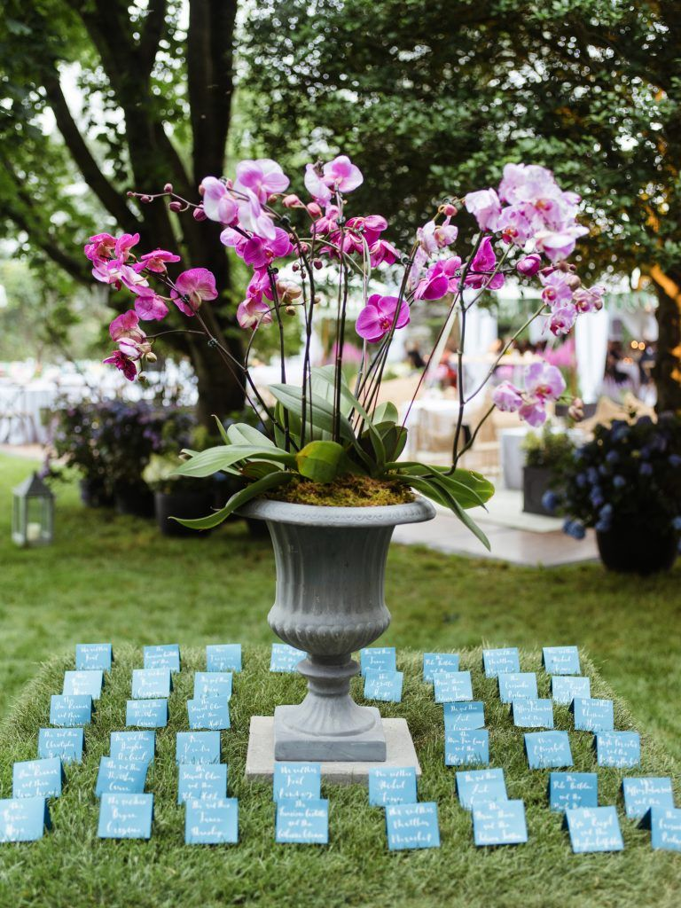 Wedding decorations accessories december 2018 Pink orchid centerpiece grass covered escort card table by Tara