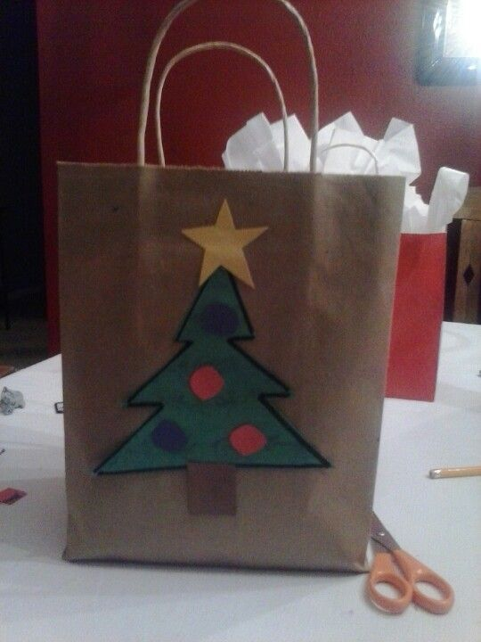 Cheap Way To Decorate A Christmas Bag Construction Paper And Brown Paper Bag Paper Bag Decoration Christmas Crafts For Kids Christmas Crafts