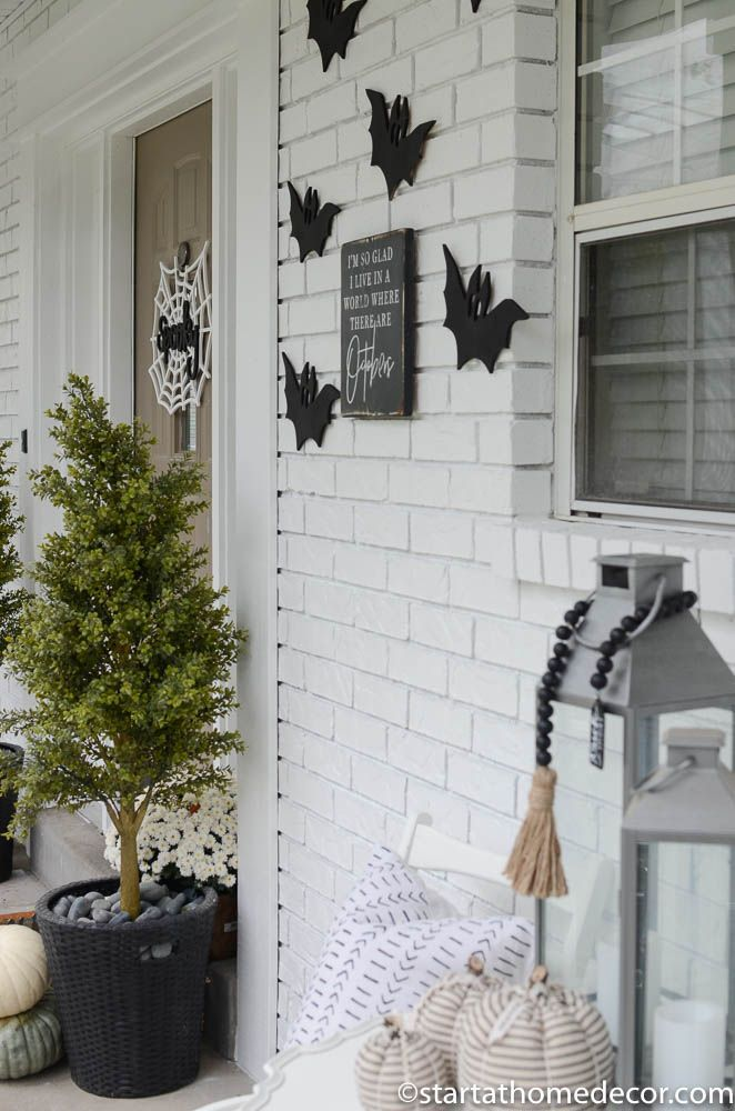 DIY Halloween Front Porch #sideporch Create a black and white Halloween front porch #fallfrontporchdecor