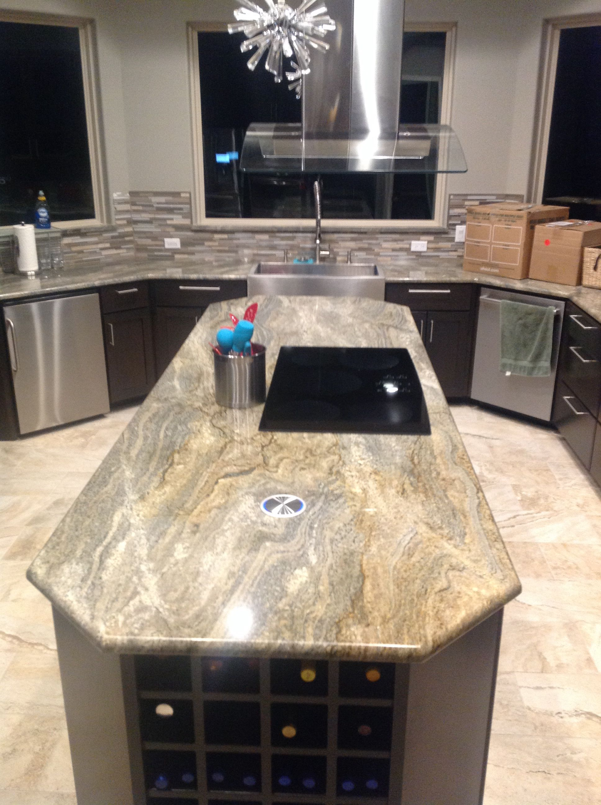 """9' island kitchen with extra 3"""" raised cabinets, also ..."""