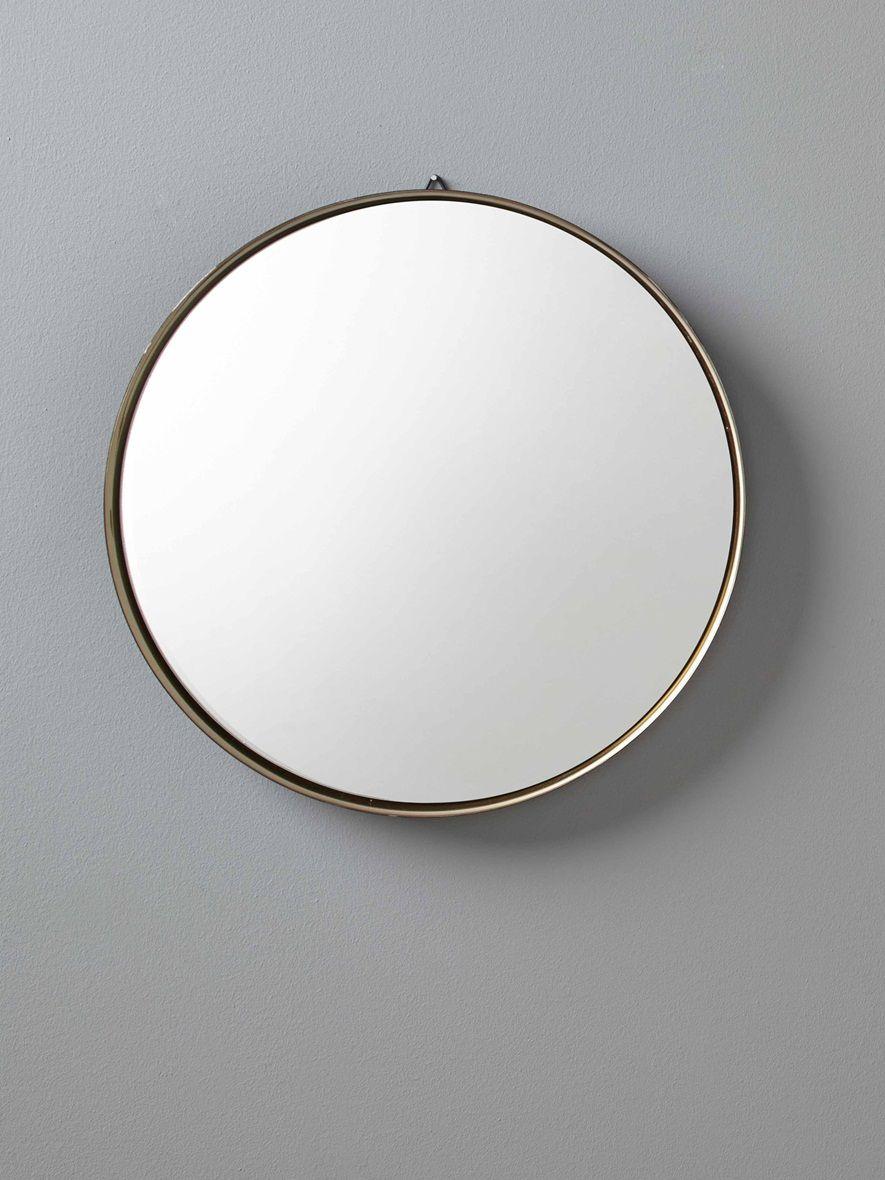 Noir  l extérieur doré  l intérieur ce grand miroir rond apporte
