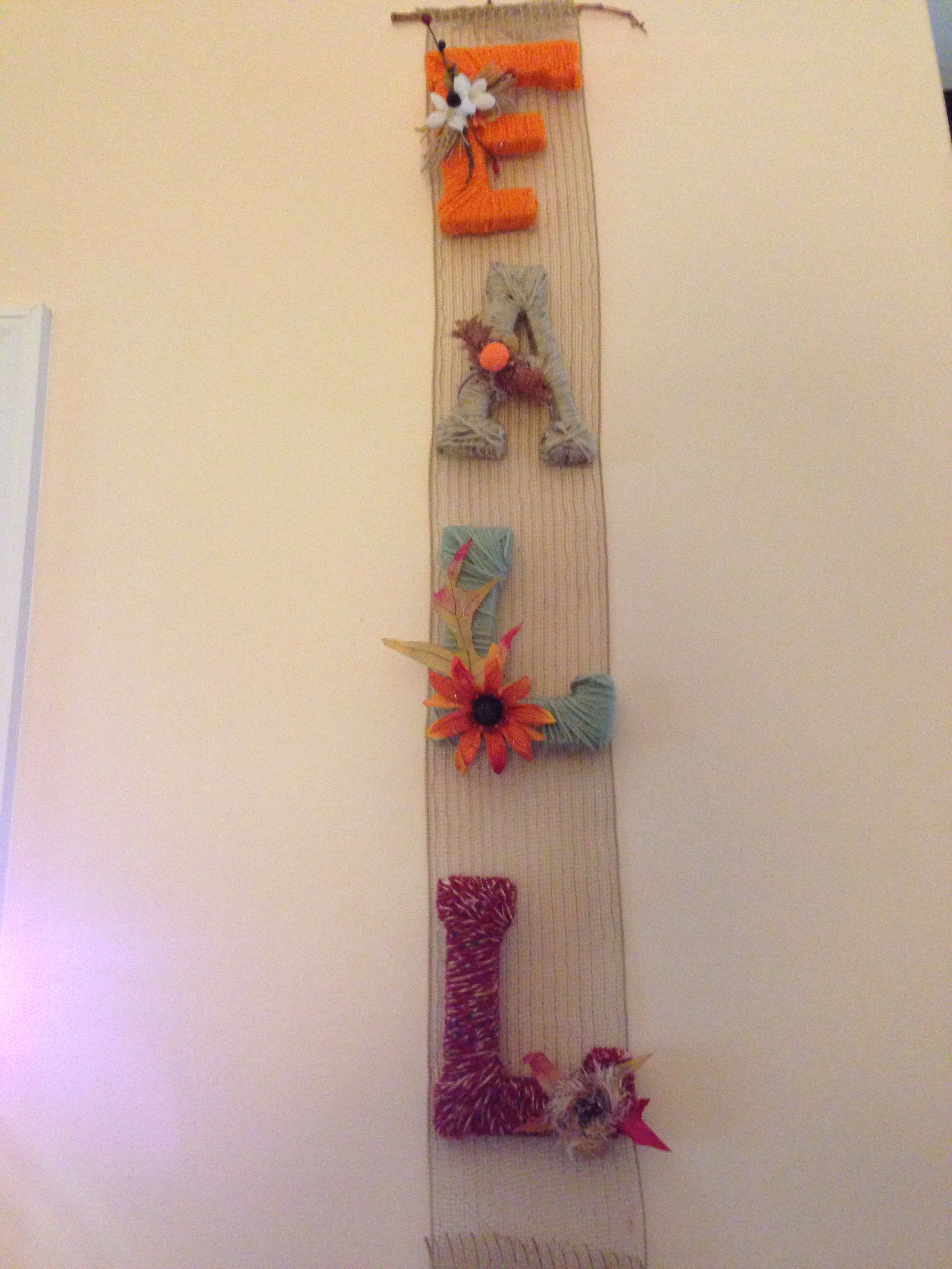 Yarn-wrapped fall wall hanging by mom