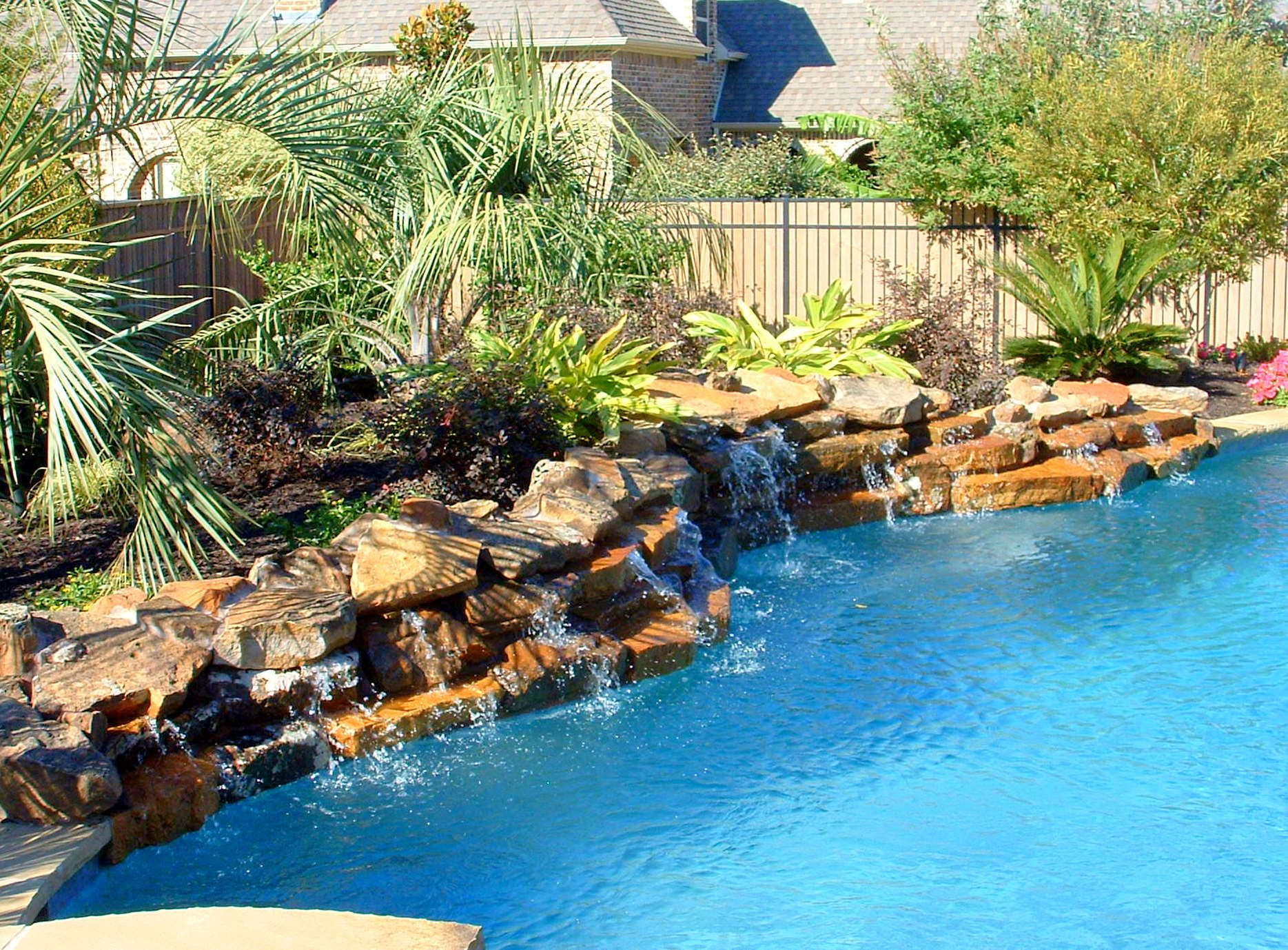 rock waterfalls low profile rock waterfall swimming pool feature southlake texas - Cool Pools With Waterfalls In Houses