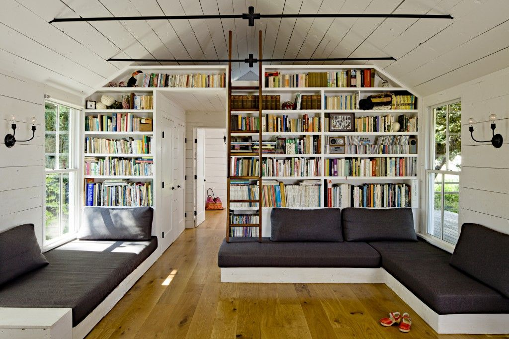 whitewashed walls and ceiling made from reclaimed wood. i like the built-in bookshelves and couches/day-beds.