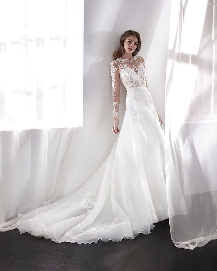 Long sleeve dress with an A-line skirt + medium traing, winter wedding dress