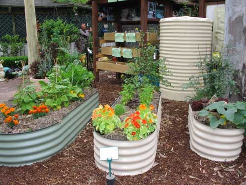 Corrugated iron can be used to make round or creatively for Circular raised garden bed ideas