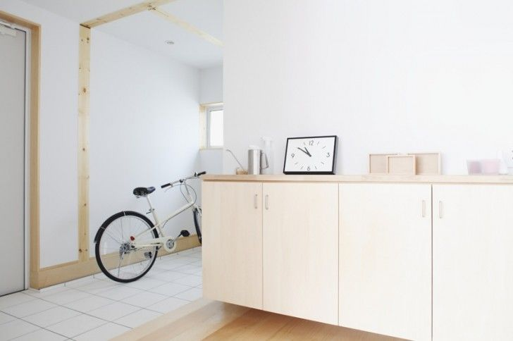 Interior Design, Porcelain Tile Floor Hallway Clock Brown Yellowish Wooden Cabinet Wooden Floor White Wall And Bicycle ~ Lovely Open Plan Interior with Spacious and Minimalist Impression