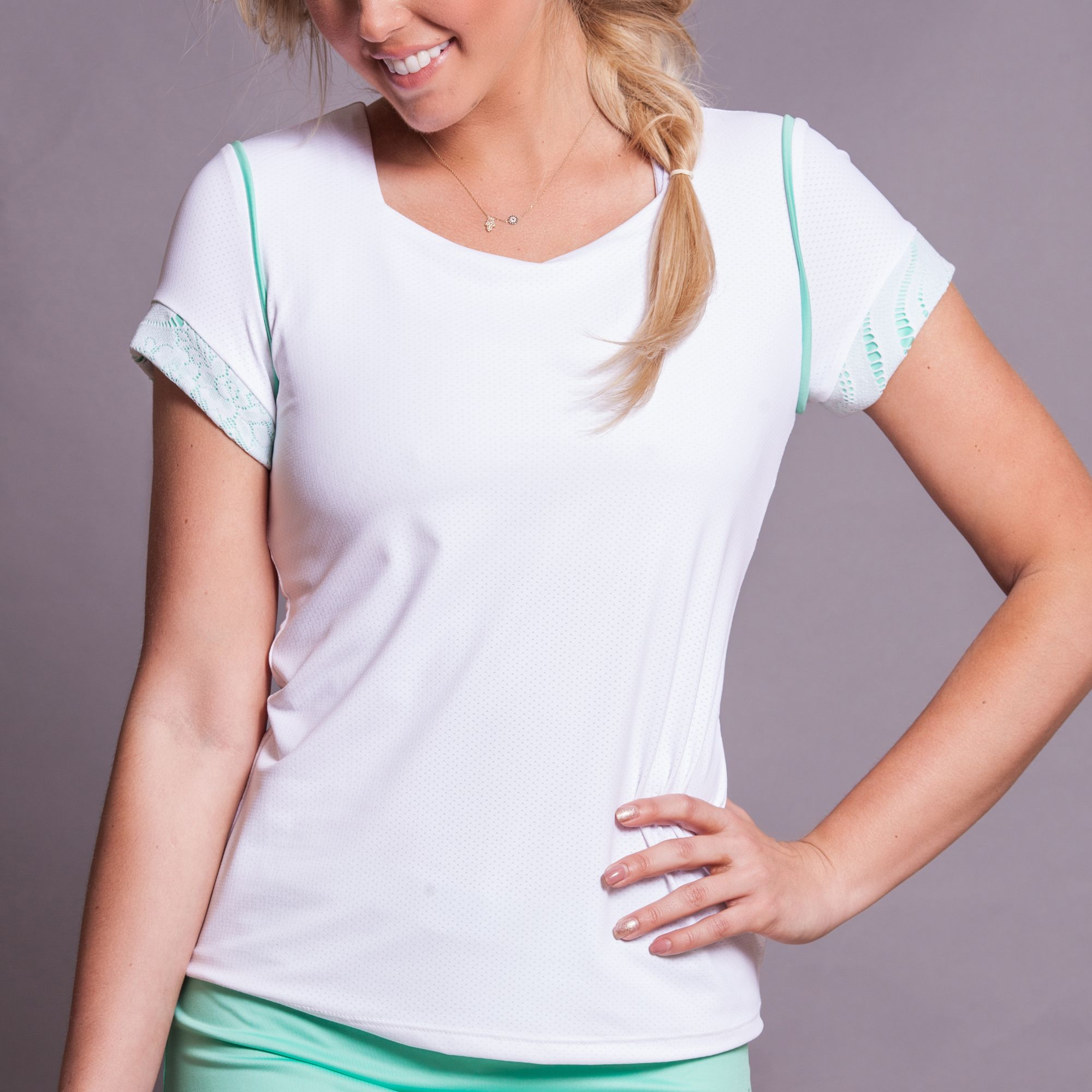 Soft microfiber -mesh cap sleeve, tennis top with green piping detail. Made in USA. SHOP tennis clothes http://www.denisecronwall.com/#!product/prd13/2521066851/calypso-cap-sleeve-top
