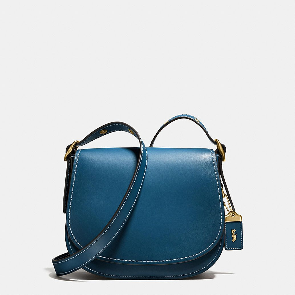 Shop The COACH Saddle 23 In Glovetanned Leather. Enjoy Complimentary Shipping & Returns! Find Designer Bags, Wallets, Shoes & More At COACH.com!