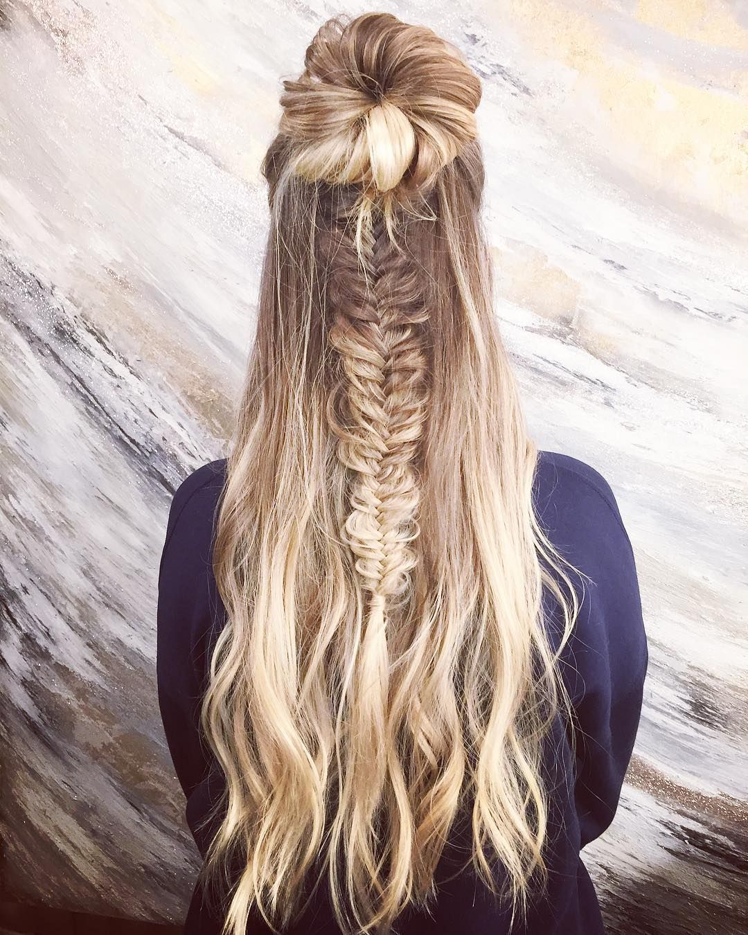 Half up half down fishtail hairstyle