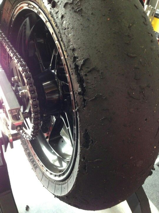 Moto GP tire...that's some serious knee dragging!!!... Over cooked and chunked at maximum lean ...