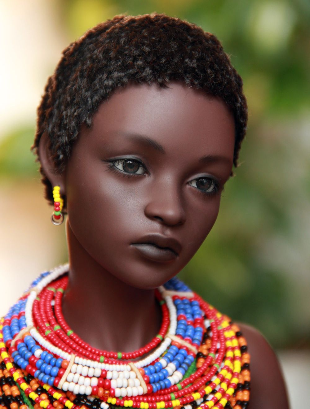 I have no details on who made this doll. All I know is that she's incredible!