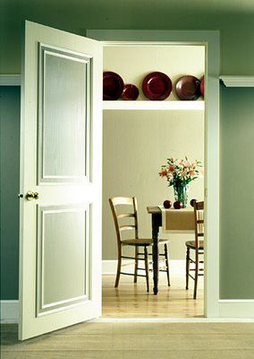 Exceptional Restyled Home: No Ordinary Door... Molding And A Little Paint To Change