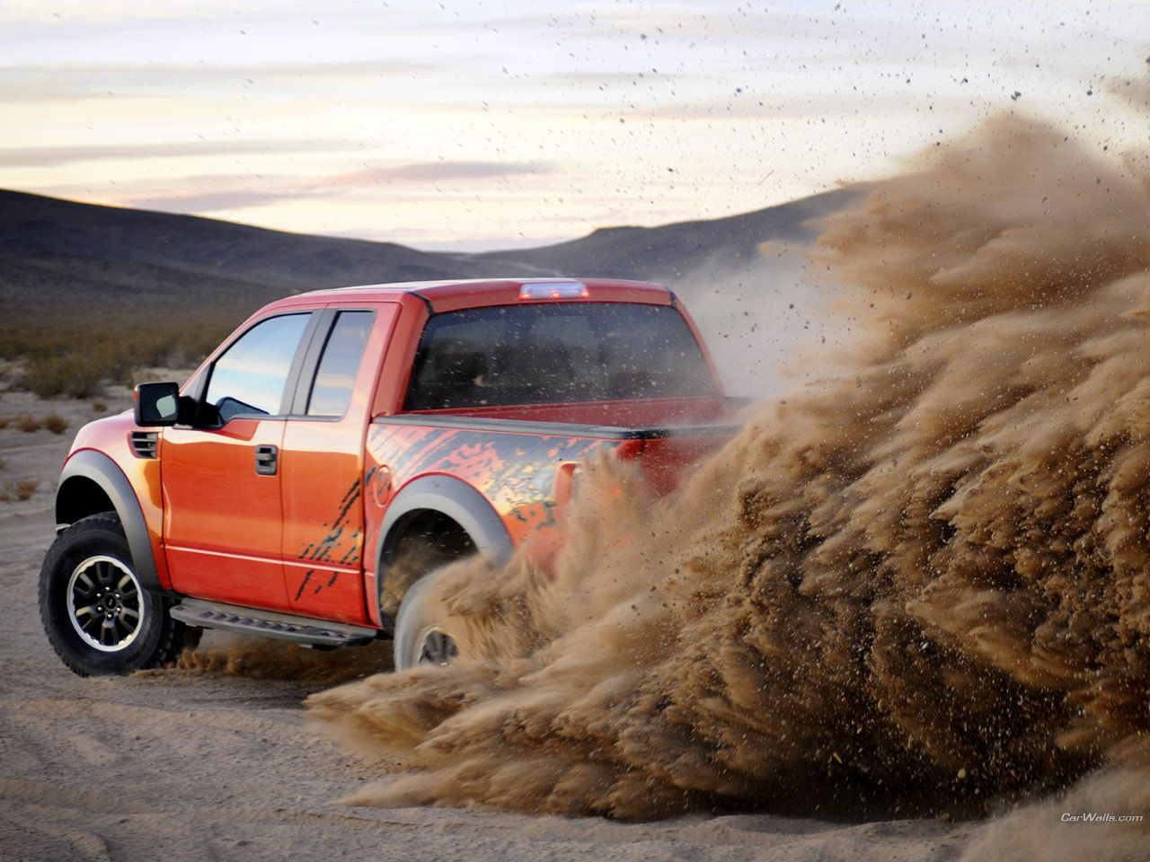 Ford raptor svt f 150 truck rolling in the dust