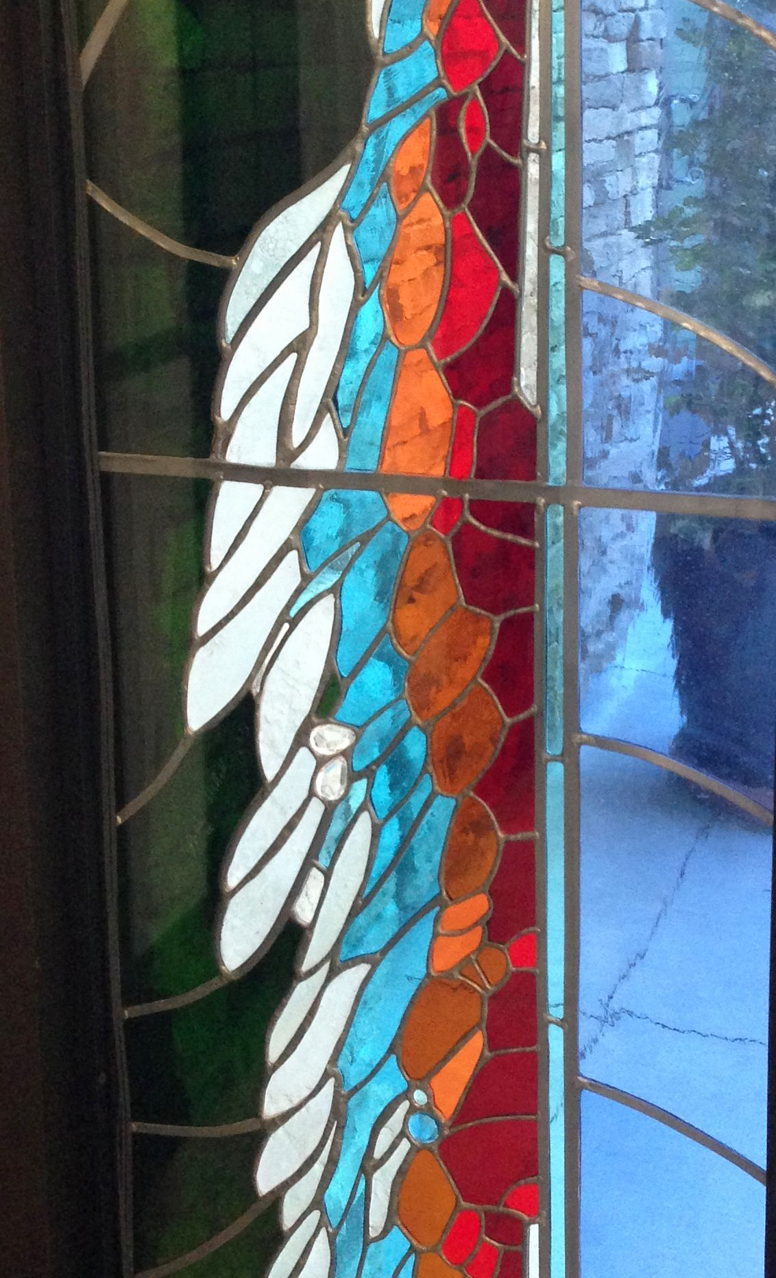 Ramona Library. Detail of stained glass by James Hubbell.