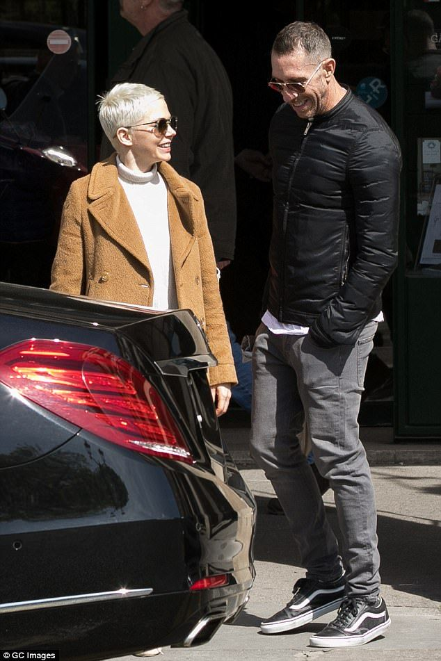 Having a giggle: The actress laughed with her male friend as she left the museum, shielding her eyes from the sun's glare with a pair of large chic sunnies