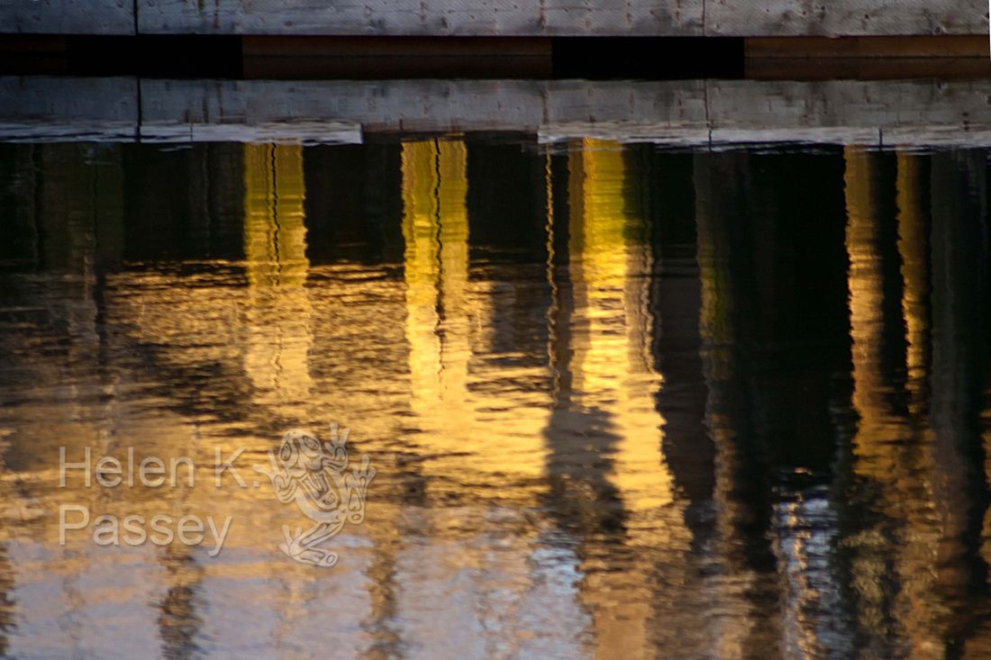 Industrial Gold: reflections of a frosty December sunset at a commercial boatyard at the Everett Marina.