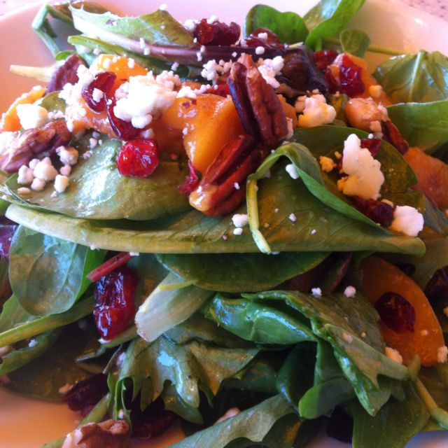Spinach salad with Gorgonzola, dried cranberries, grilled peaches