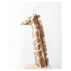 Tower over the rest with this surprisingly easy-to-make kid's Halloween giraffe costume. #giraffecostumediy Tower over the rest with this surprisingly easy-to-make kid's Halloween giraffe costume. #giraffecostumediy