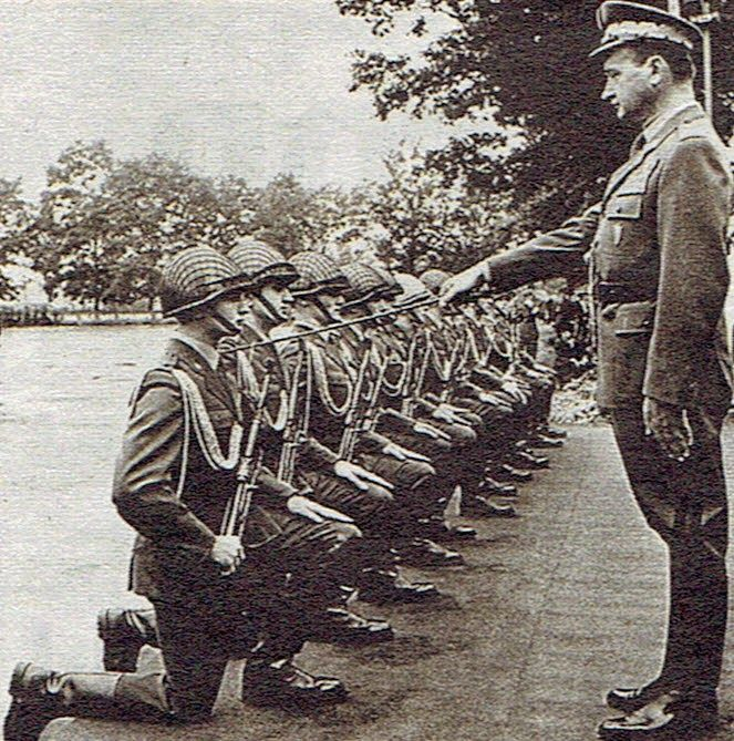 Enlisted infantrymen of the Polish People's Army getting promoted to the ranks of commissioned officers by defense minister gen. Wojciech Jaruzelski.