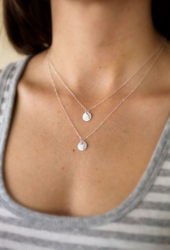 Silver-tone beads and lightly hammered medallions know just how to glisten on this elegant double-strand necklace. Dimensions: