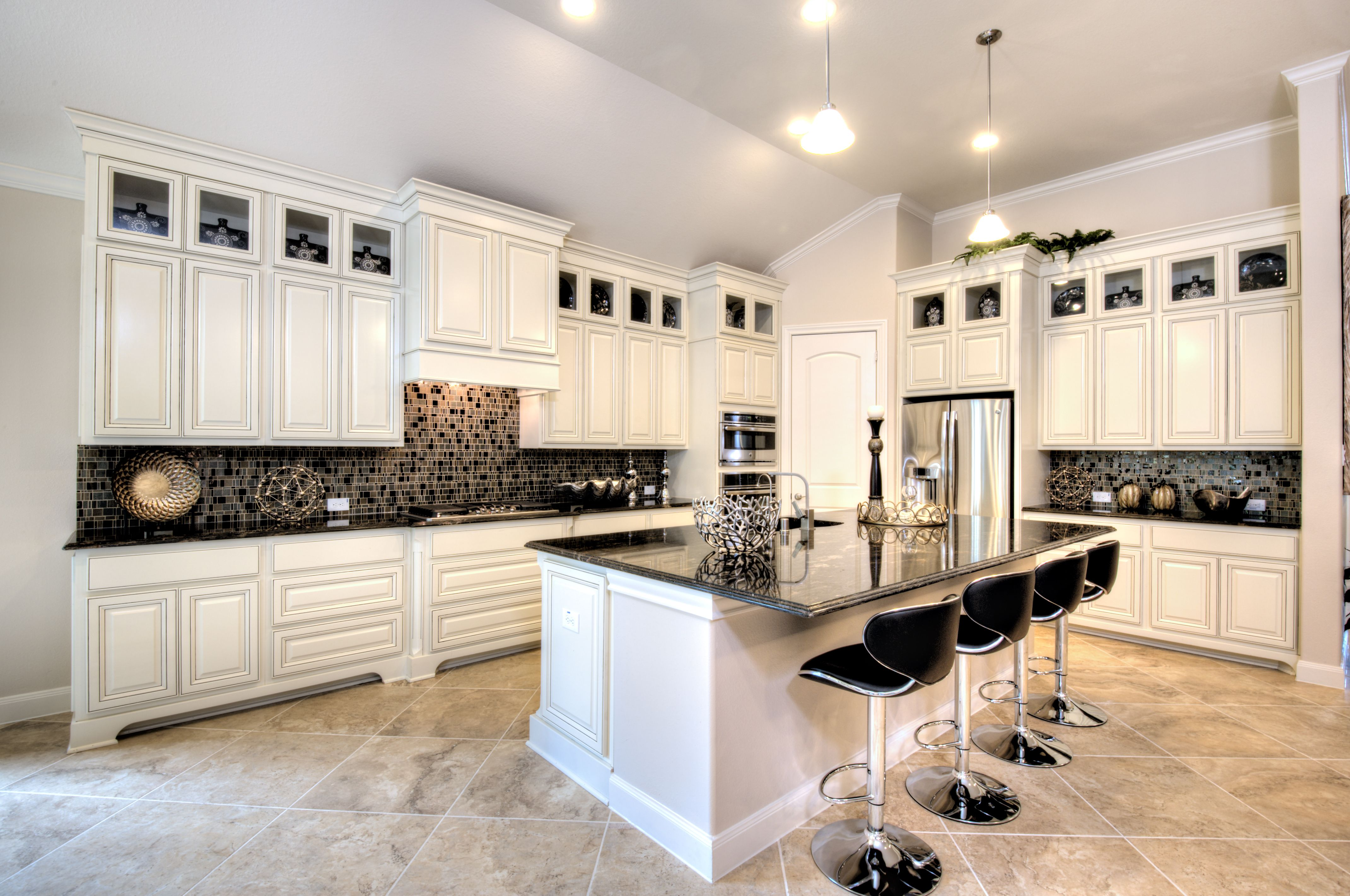 Classic white #cabinets accented with chic #modern chairs ...