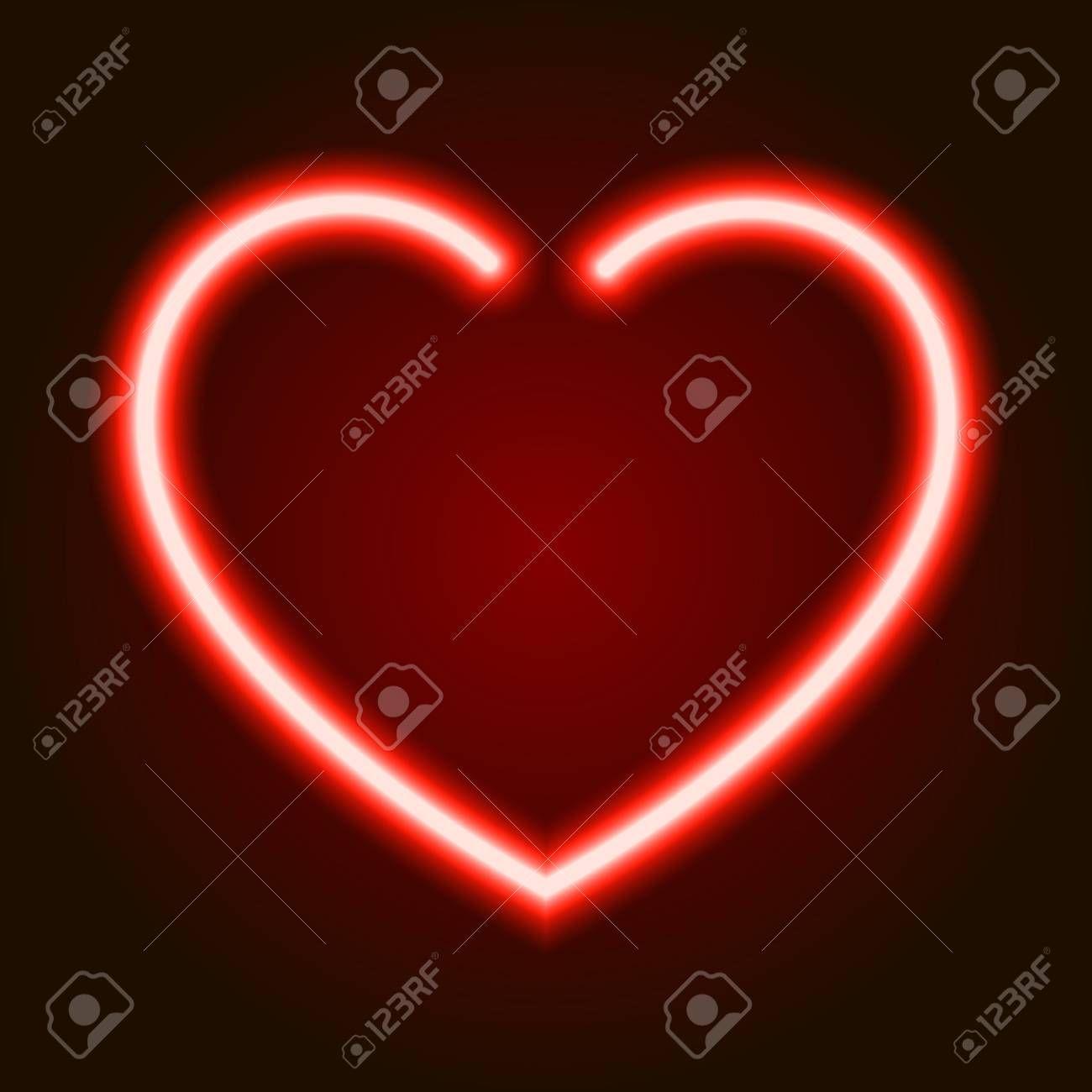 Red neon glowing heart symbol of love on dark background