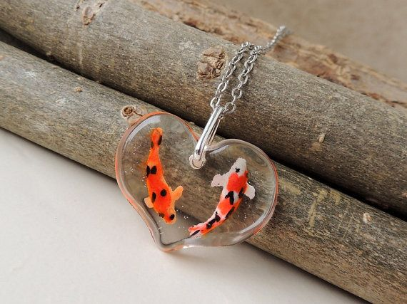 Two koi necklace tiny koi carp fish swimming in a for Tiny koi fish