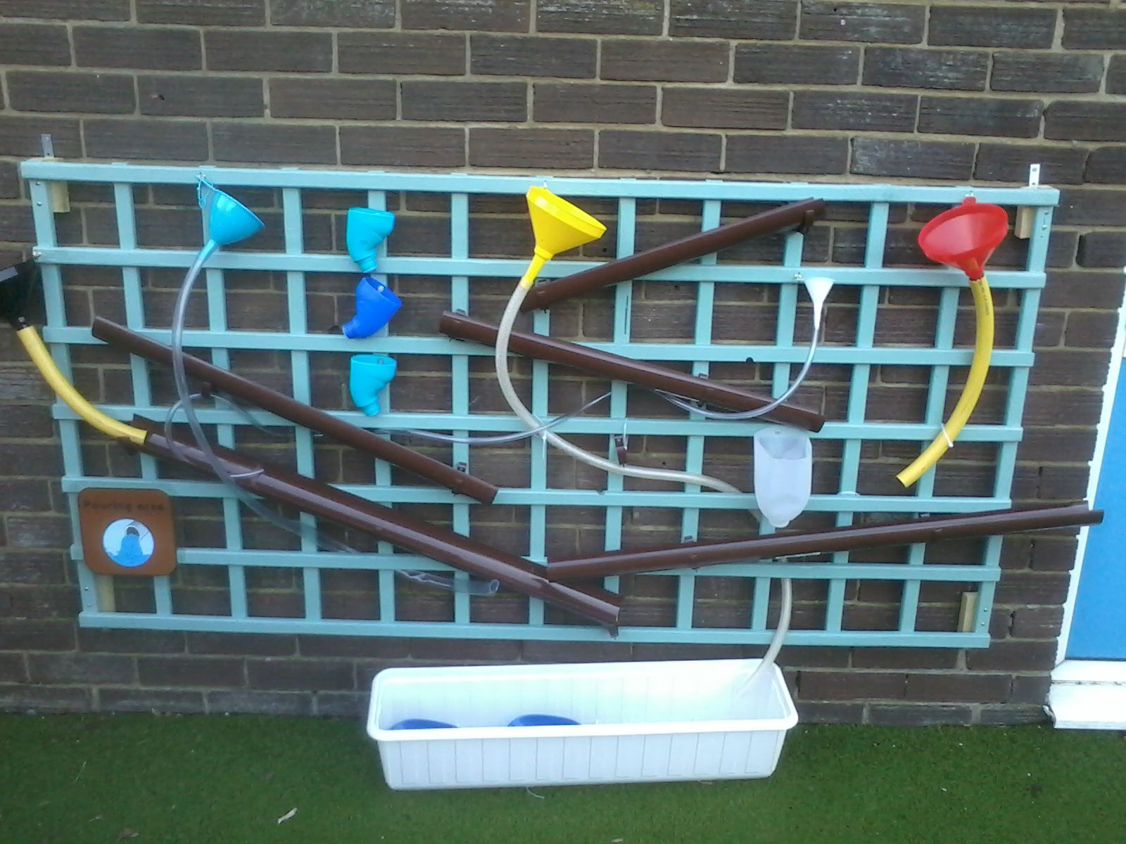 eyfs outdoor provision - pouring wall - water wall - gutterering