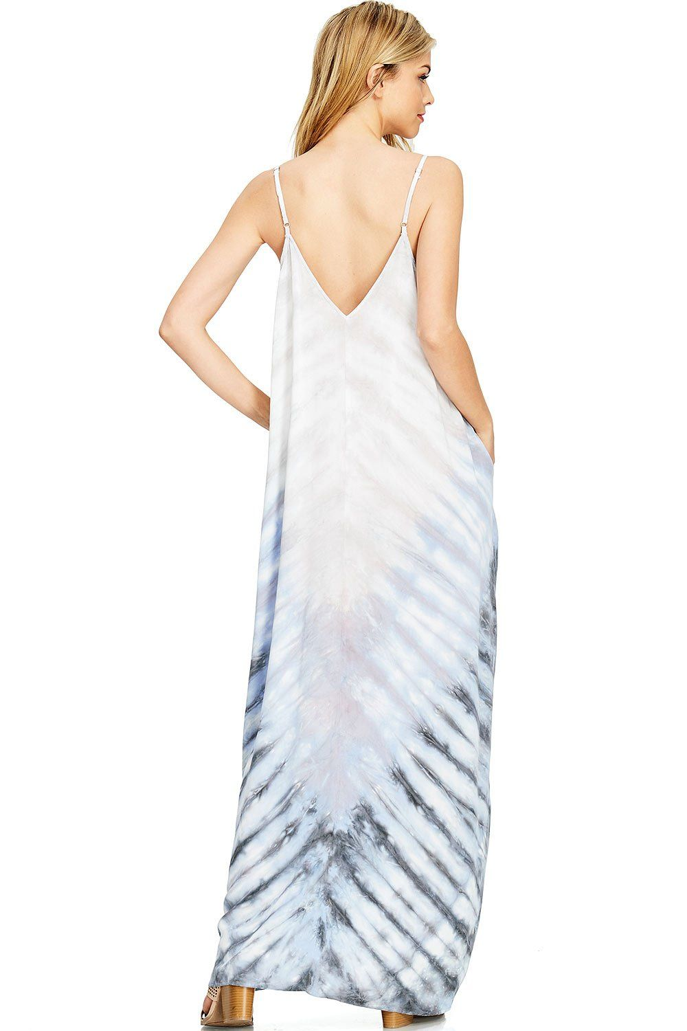 1ebe1d13f0 Light and airy maxi dress with a front and back V-neckline and a whimsical  pastel tie-dye design. Harem fit with pockets at the sides and adjustable  straps.