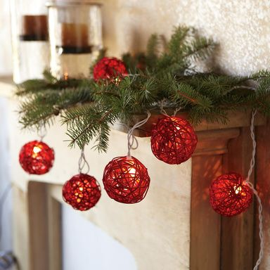 HOLIDAY BALLS LIGHT STRING Openweave orbs woven of red rattan may be