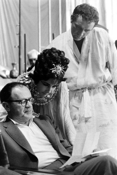 <strong>Not published in LIFE.</strong> Elizabeth Taylor and Richard Burton with director Joseph L. Mankiewicz on the set of <i>Cleopatra</i>, Rome, 1962.