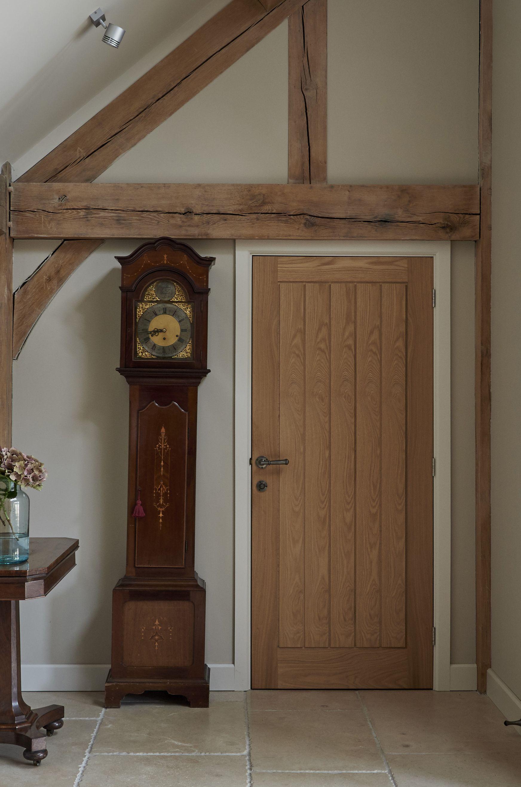 Oak Board Door With Painted Architrave And Skirting Oak Door Frames Internal Oak Doors Oak Doors